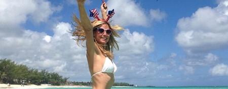 Who takes the racy photos of Heidi Klum?