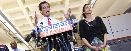 Despite new photos, Weiner stays in race