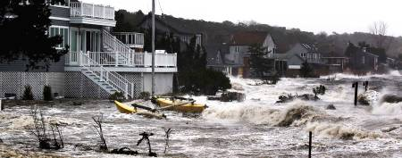 Storm surf kicked up by the high winds from Hurricane Sandy break onto homes in Southampton, N.Y., on Monday, Oct. 29, 2012. (Lucas Jackson/Reuters)