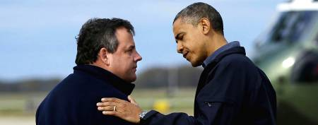 Pres. Barack Obama is greeted by New Jersey Gov. Chris Christie at Atlantic City International Airport, October 31, 2012. (Pablo Martinez Monsivais/AP)