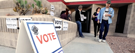 All eyes turn to the swing states, including Ohio, where voters line up at the polls in Newark. (Matt Sullivan/Reuters)