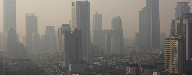 Buildings and cars are seen in the haze in downtown Shanghai on Dec. 2, 2013. (Aly Song/Reuters)