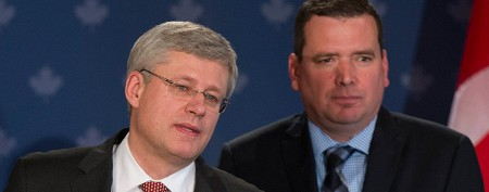Prime Minister Stephen Harper and Minister for International Development Christian Paradis (Graham Hughes / Canadian Press)