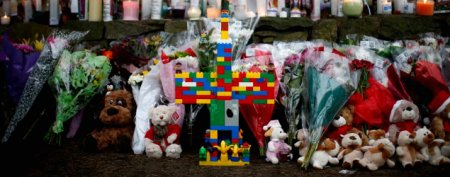 A cross made of Lego toys stands at a makeshift memorial near the Sandy Hook Elementary School for the victims of a school shooting in Newtown. (Reuters)