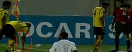 An explosive nearly went off in an Iranian soccer player's hand during a match. (YouTube)