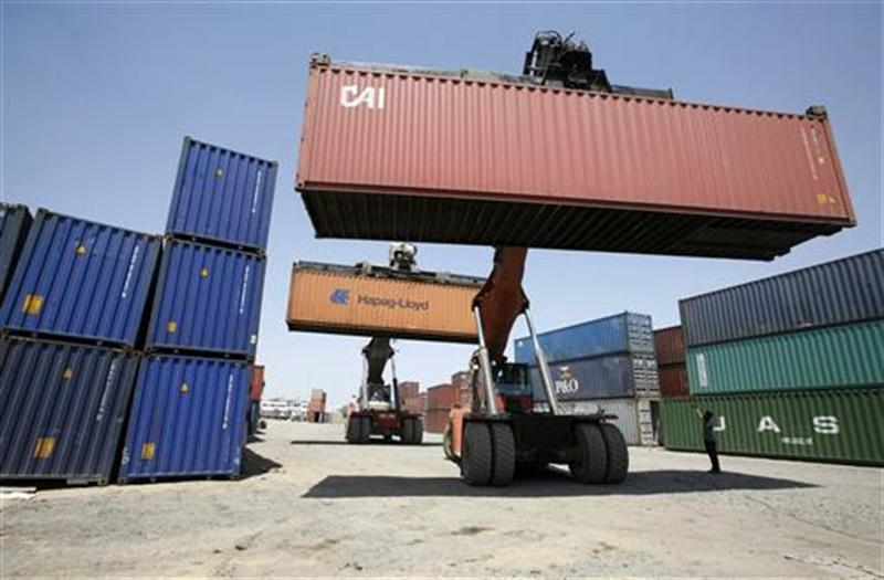 Mobile cranes prepare to stack containers at Thar Dry Port in Sanand in the western Indian state of Gujarat