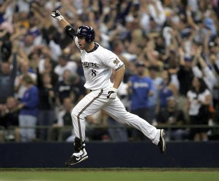 Batter Ryan Braun celebrates his home run to give the Milwaukee Brewers the NL wild card