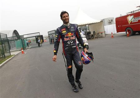 Red Bull Formula One driver Webber returns to the garage area after retiring from the race during the Indian F1 Grand Prix at the Buddh International Circuit in Greater Noida