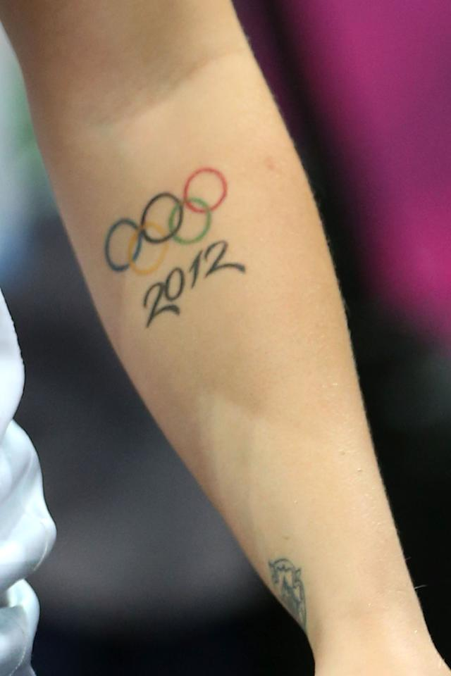 Detail photo of a 2012 Olympic tattoo on Kelsi Fairbrother of Great Britain during the Women's Handball Preliminaries Group A match between Great Britain and Brazil on Day 5 of the London 2012 Olympic Games at The Copper Box on August 1, 2012 in London, England.  (Photo by Jeff Gross/Getty Images)
