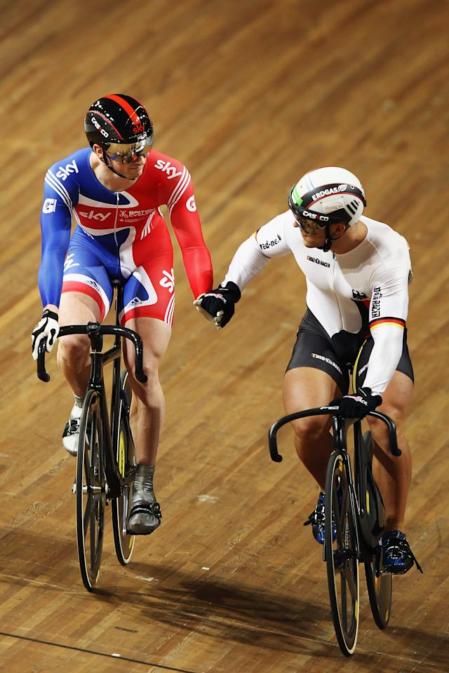 APELDOORN, NETHERLANDS - OCTOBER 22: Jason Kenny (l) of Great Britain shakes hands with Robert Forstemann of Germany after beating him in the 1/4 finals of the Men's Sprint during during day two of the 2011 Track Cycling European Championships at Omnisport Apeldoorn on October 22, 2011 in Apeldoorn, Netherlands.  (Photo by Bryn Lennon/Getty Images)