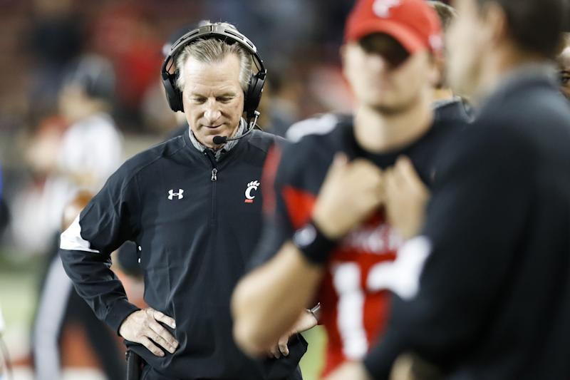Tuberville resigns after coaching Cincinnati for 4 seasons