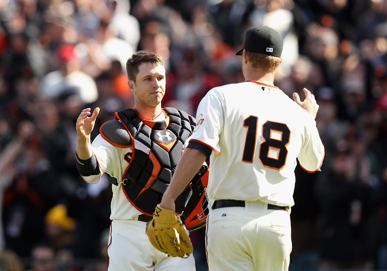 SAN FRANCISCO, CA - APRIL 13:  Matt Cain #18 of the San Francisco Giants is congratulated by Buster Posey #28 after they beat the Pittsburgh Pirates at AT&T Park on April 13, 2012 in San Francisco, California.  (Photo by Ezra Shaw/Getty Images)
