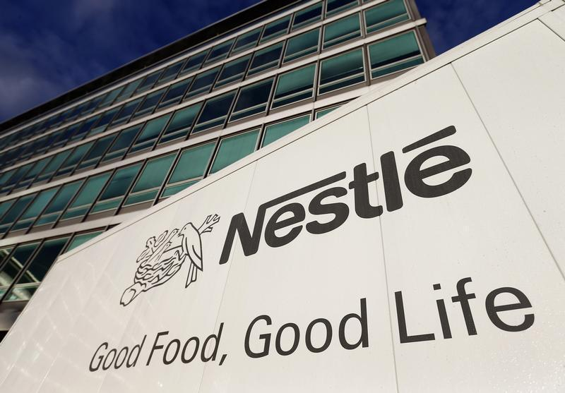 The Nestle logo is pictured on a truck outside the company's headquarters before the nine-month sale figures news conference in Vevey