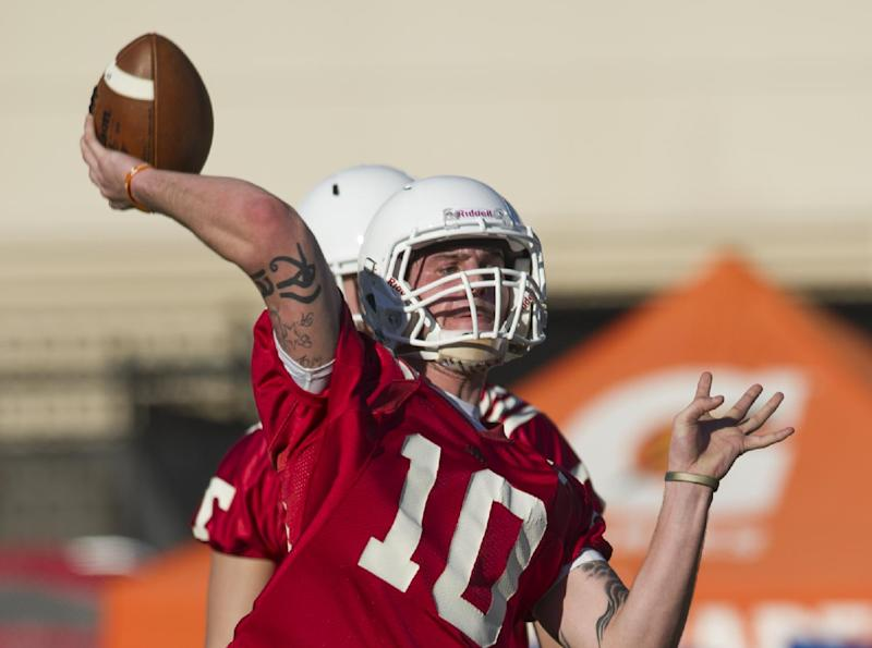 In this March 7, 2014 photo, Tennessee quarterback Riley Ferguson throws a pass during an NCAA college spring practice in Knoxville, Tenn. Tennessee coach Butch Jones is still waiting for someone to separate themselves from the rest in the Volunteers' four-man quarterback competition as spring practice draws to a close