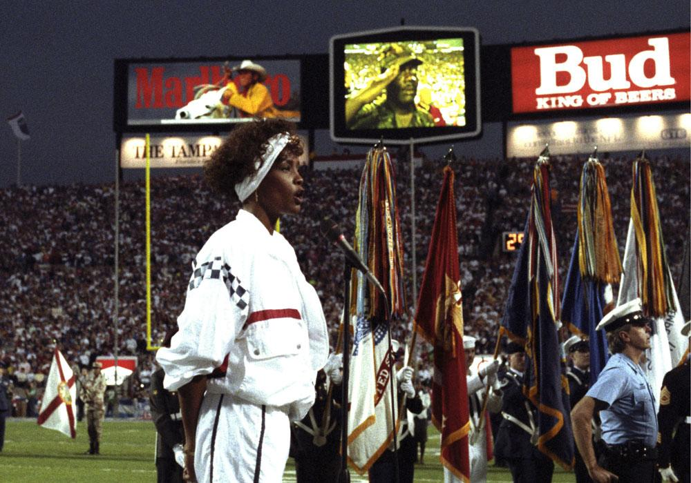 Whitney Houston lip syncs the national anthem before  Super Bowl XXV on January 27, 1991 in Tampa. The New York  Giants defeated the Buffalo Bills 20 - 19.  (Photo by Al Messerschmidt/Getty Images)