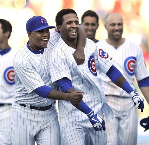 Cubs win 6-5 in 14 to end Reds' streak at Wrigley