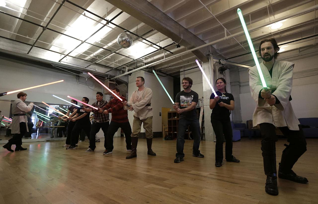 Golden Gate Knights instructor Alain Block, right, teaches during class in San Francisco, Sunday, Feb. 10, 2013. A group of San Francisco Star Wars fans who want to travel to a galaxy not that far away have created a combat choreography class for Jedis-in-training with their weapon of choice: the light saber. (AP Photo/Jeff Chiu)