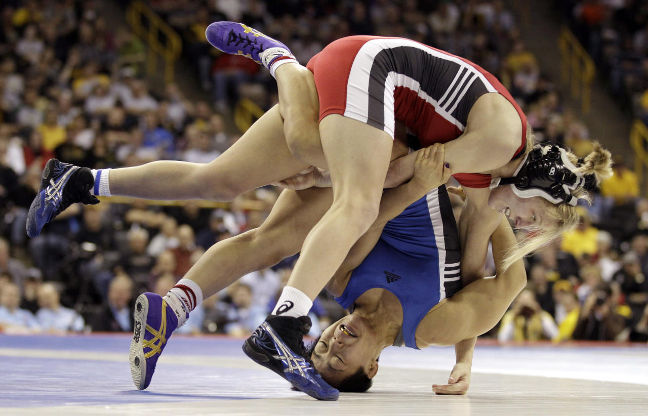 Alyssa Lampe, top, of Colorado Springs, Colo., takes down Clarissa Chun, also of Colorado Springs, during their 48kg freestyle finals match at the U.S. Olympic Wrestling Team Trials, Sunday, April 22, 2012, in Iowa City, Iowa. (AP Photo/Charlie Neibergall)