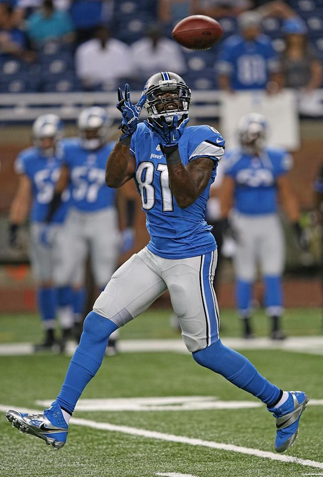 DETROIT, MI - AUGUST 09: Calvin Johnson #81 of the Detroit Lions warms up prior to the start of the pre-season game against the New York Jets at Ford Field on August 9, 2013 in Detroit, Michigan. (Photo by Leon Halip/Getty Images)