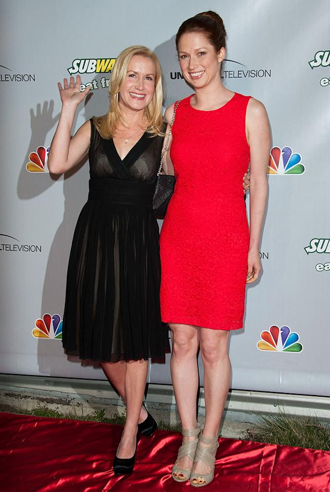"Angela Kinsey and Ellie Kemper arrive at ""The Office"" series finale wrap party at Unici Casa Gallery on March 16, 2013 in Culver City, California."