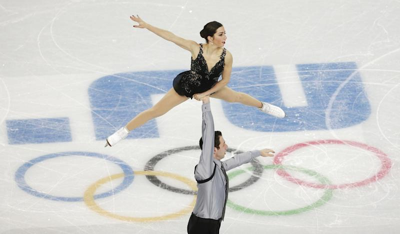 Marissa Castelli and Simon Shnapir of the United States compete in the team pairs free skate figure skating competition at the Iceberg Skating Palace during the 2014 Winter Olympics, Saturday, Feb. 8, 2014, in Sochi, Russia. (AP Photo/Bernat Armangue)
