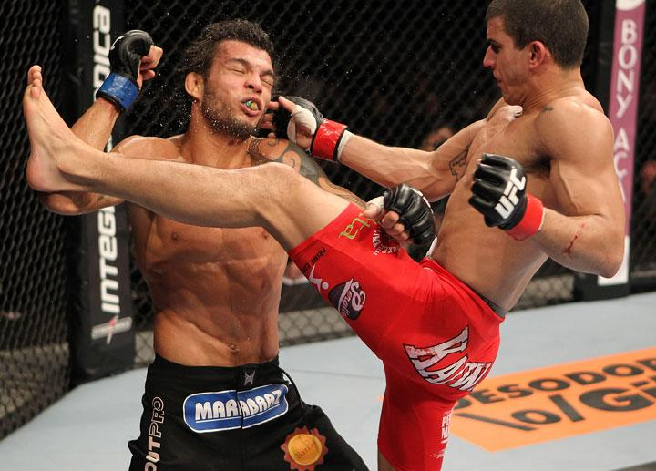 BELO HORIZONTE, BRAZIL - JUNE 23:   (R-L) Felipe Arantes lands a flying knee against Milton Vieira  during their UFC 147 featherweight bout at Estadio Jornalista Felipe Drummond on June 23, 2012 in Belo Horizonte, Brazil.