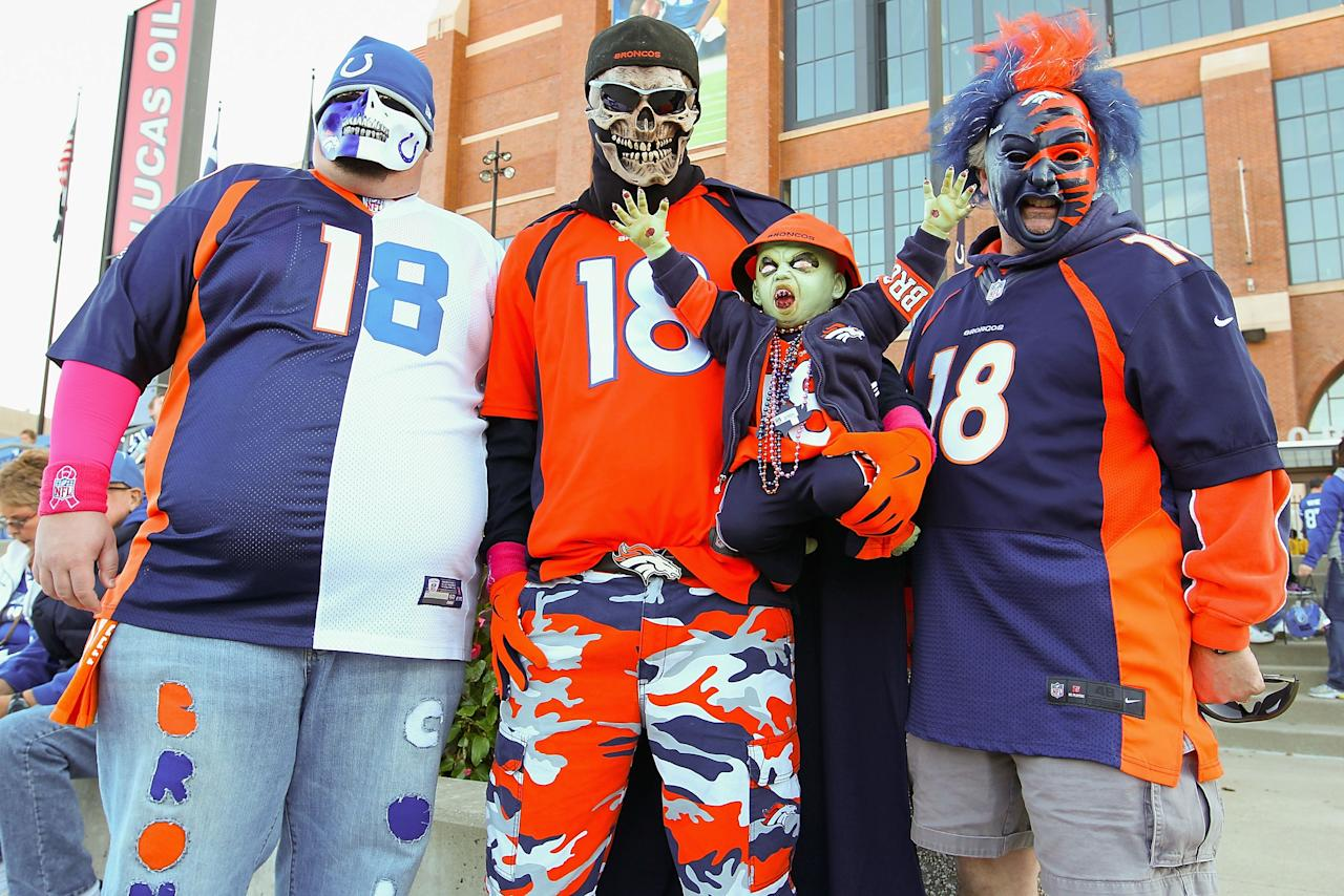 INDIANAPOLIS, IN - OCTOBER 20: A Peyton Manning fans pose for a photograph outside Lucas Oil Stadium prior to a game between the Indianapolis Colts and the Denver Broncos on October 20, 2013 in Indianapolis, Indiana. (Photo by Dilip Vishwanat/Getty Images)