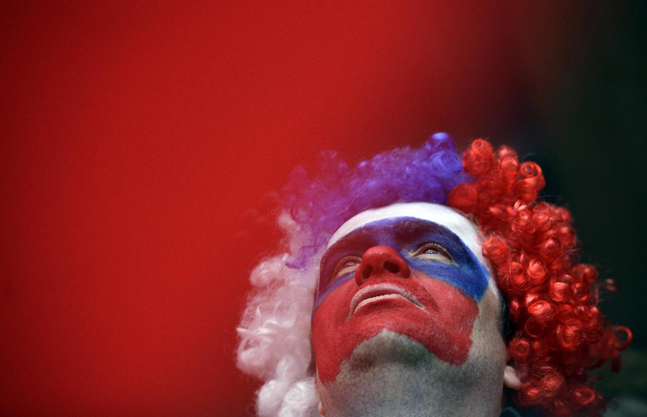 A Russian fan watches the finals during the men's two-man bobsled competition at the 2014 Winter Olympics, Monday, Feb. 17, 2014, in Krasnaya Polyana, Russia. (AP Photo/Jae C. Hong)