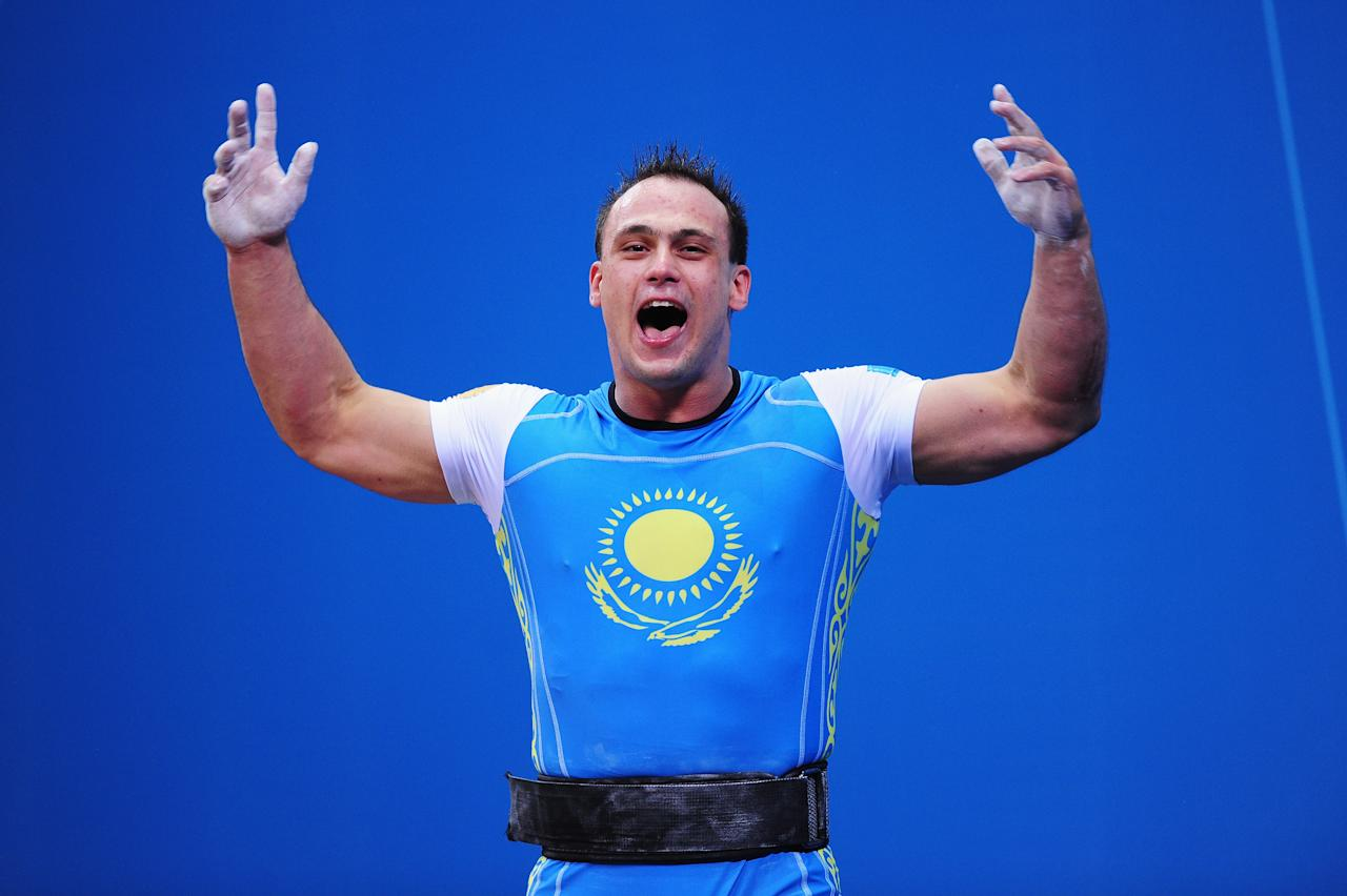 LONDON, ENGLAND - AUGUST 04:  Ilya Ilyin of Kazakhstan celebrates setting a new world record and winning the gold medal in the Men's 94kg Weightlifting final on Day 8 of the London 2012 Olympic Games at ExCeL on August 4, 2012 in London, England.  (Photo by Mike Hewitt/Getty Images)