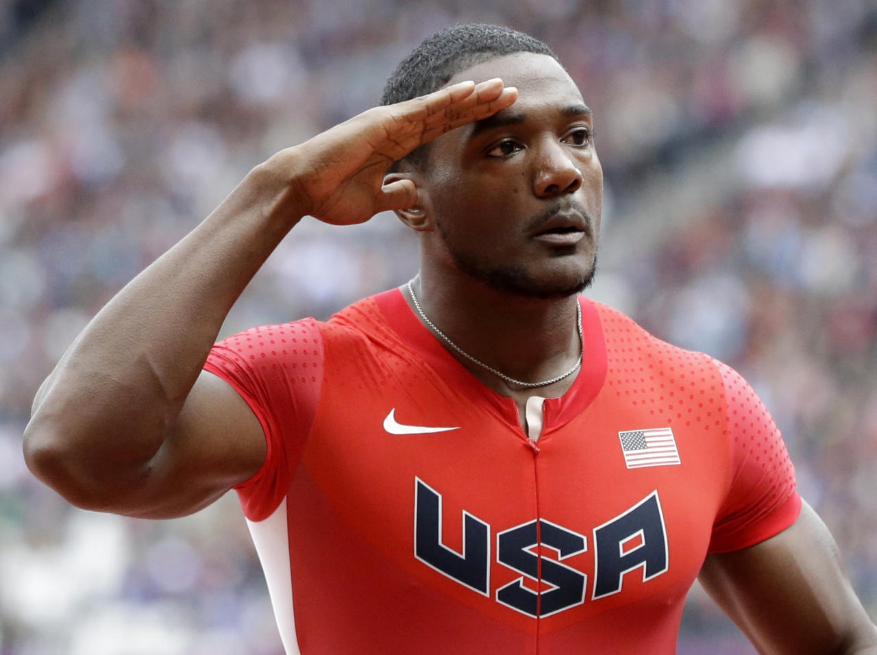 United States' Justin Gatlin reacts after his heat in the men's 100-meters during the athletics in the Olympic Stadium at the 2012 Summer Olympics, London, Saturday, Aug. 4, 2012. (AP Photo/Lee Jin-man)