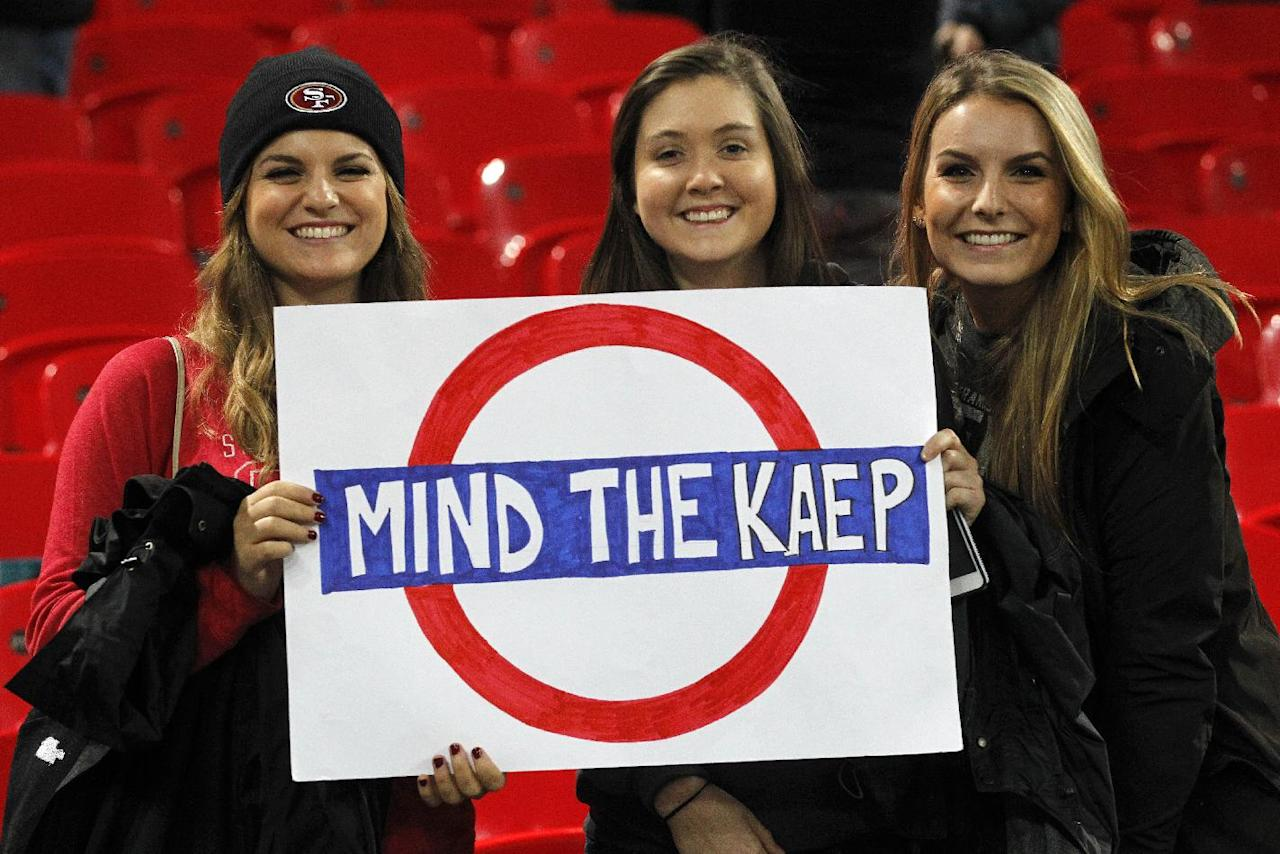 49ers fans hold a banner which plays on the London Underground public announcement 'Mind the Gap' supporting San Francisco 49ers quarterback Colin Kaepernick (7) at the end of the NFL football game between San Francisco 49ers and Jacksonville Jaguars at Wembley Stadium in London, Sunday, Oct. 27, 2013. The 49ers won the match 42-10. (AP Photo/Sang Tan)