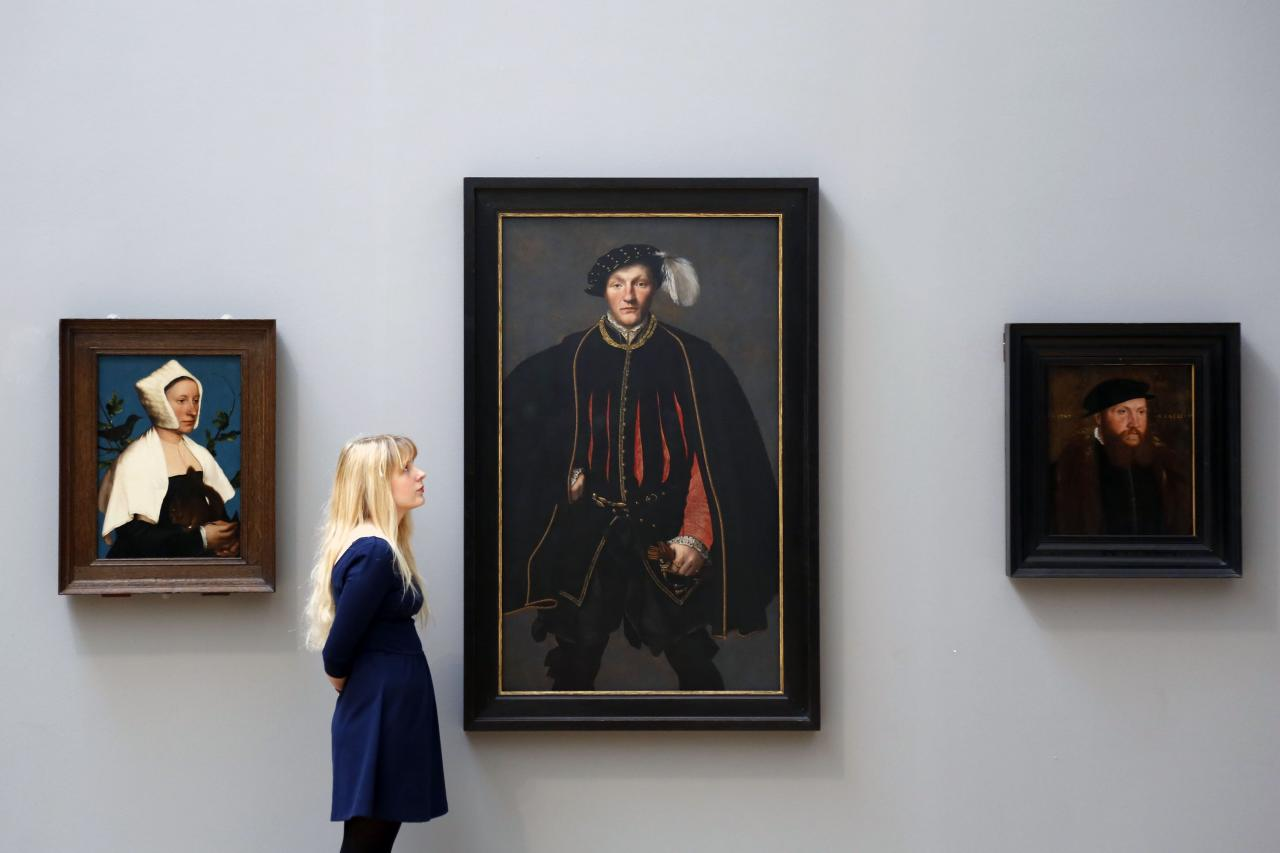 LONDON, UNITED KINGDOM - MAY 13: A woman admires artwork on display at the Walk through British Art at Tate Britain on May 13, 2013 in London, England. Visitors will experience a completely new presentation of the world's greatest collection of British art, the national collection of British art will be displayed in a continuous and purely chronological display from the 1500s to the present day. (Photo by Warrick Page/Getty Images)
