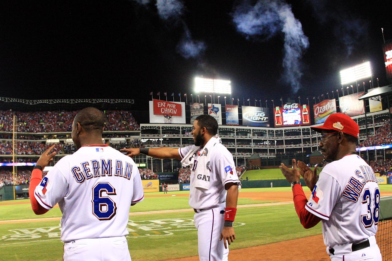 ARLINGTON, TX - OCTOBER 24: (L-R) Esteban German #6, Elvis Andrus #1 and manager Ron Washington celebrate after a solo home run by Adrian Beltre #29 in the sixth inning during Game Five of the MLB World Series against the St. Louis Cardinals at Rangers Ballpark in Arlington on October 24, 2011 in Arlington, Texas.  (Photo by Rob Carr/Getty Images)