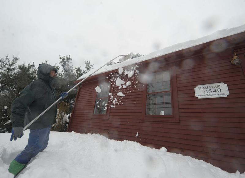 Snow, ice, water mean burdened roofs in Northeast