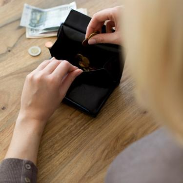 Woman-counting-money-from-wallet_slideshow