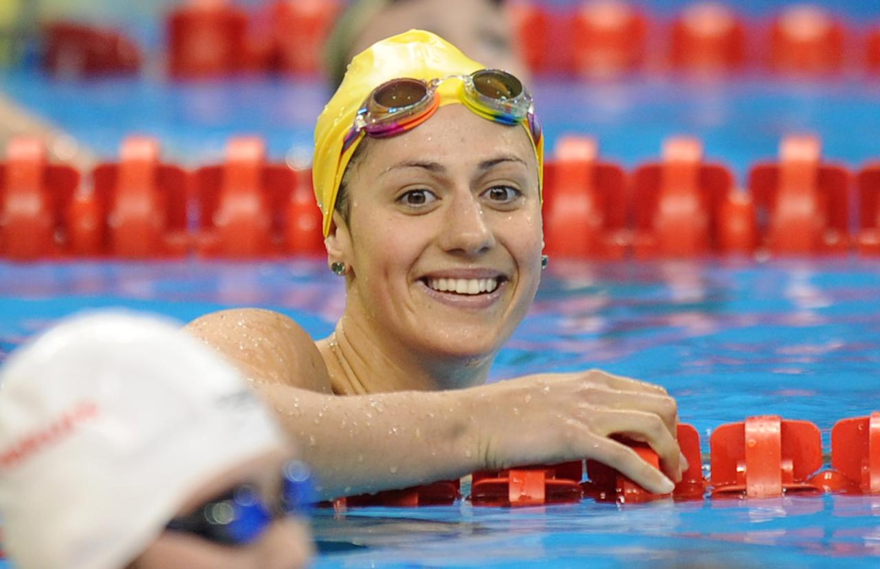 Australia's Stephanie Rice smiles after she competed in the semi-final of the women's 200-metre individual medley swimming event in the FINA World Championships at the indoor stadium of the Oriental Sports Center, in Shanghai, on July 24, 2011.  AFP PHOTO / FRANCOIS XAVIER MARIT (Photo credit should read FRANCOIS XAVIER MARIT/AFP/Getty Images)