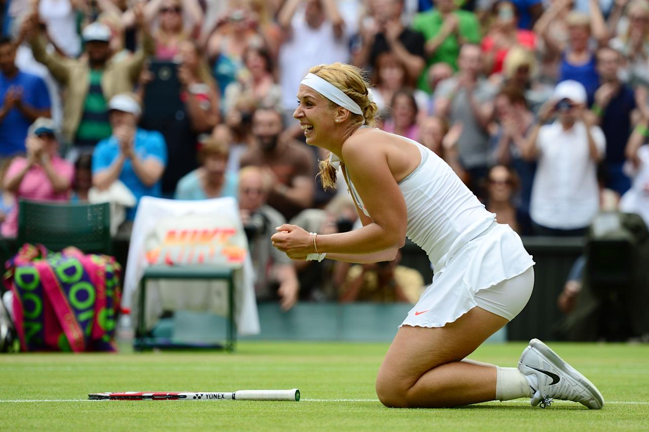 LONDON, ENGLAND - JULY 01: Sabine Lisicki of Germany celebrates match point during her Ladies' Singles fourth round match against Serena Williams of United States of America on day seven of the Wimbledon Lawn Tennis Championships at the All England Lawn Tennis and Croquet Club on July 1, 2013 in London, England. (Photo by Mike Hewitt/Getty Images)