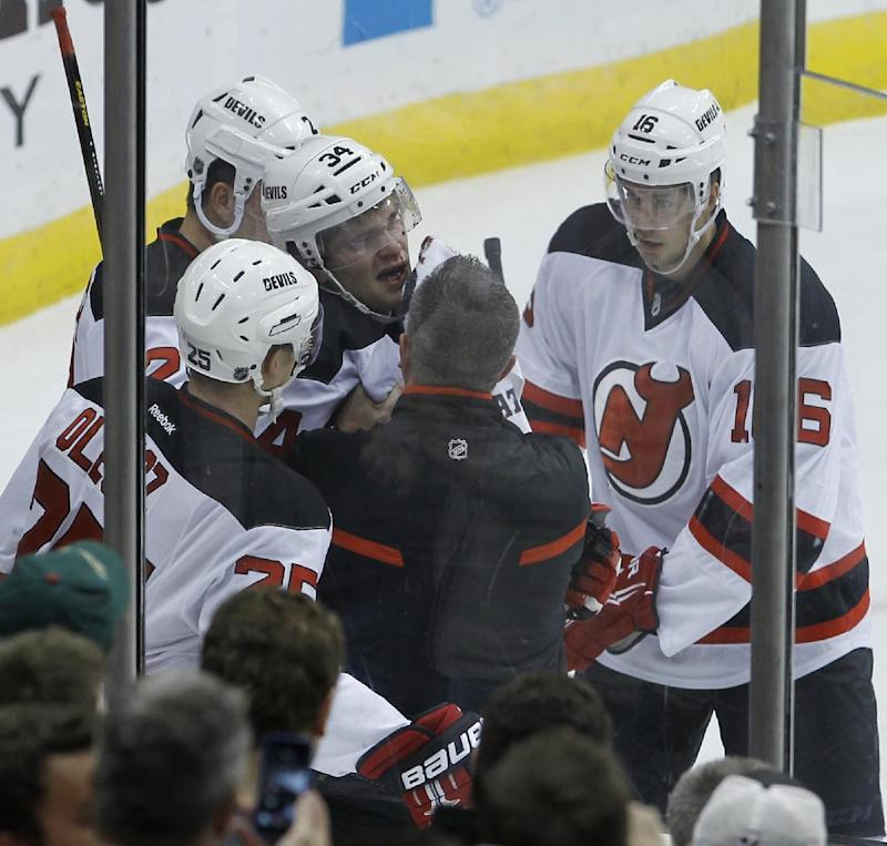 Devils D Merrill leaves 1st NHL game with injury