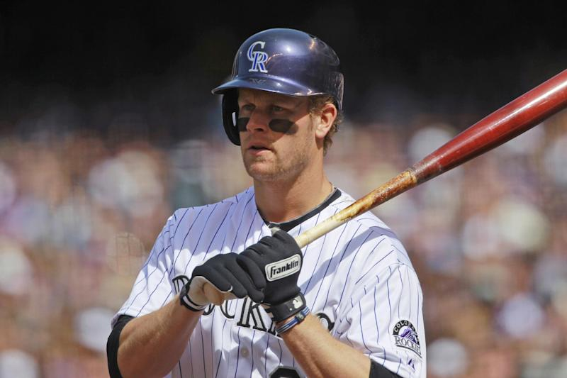 Morneau settles in at 1st base for Rockies
