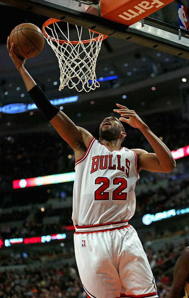 CHICAGO, IL - DECEMBER 02: Taj Gibson #22 of the Chicago Bulls lays in a shot against the New Orleans Pelicans at the United Center on December 2, 2013 in Chicago, Illinois. NOTE TO USER: User expressly acknowledges and agrees that, by downloading and or using this photograph, User is consenting to the terms and conditions of the Getty Images License Agreement. (Photo by Jonathan Daniel/Getty Images)