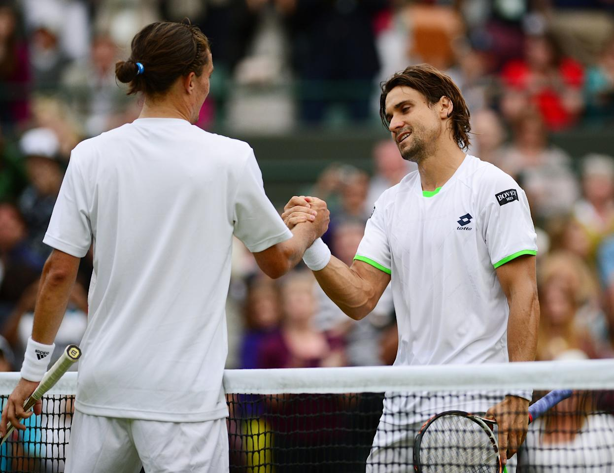 LONDON, ENGLAND - JUNE 29: David Ferrer of Spain shakes hands at the net with Alexandr Dolgopolov of Ukraine during the Gentlemen's Singles third round match on day six of the Wimbledon Lawn Tennis Championships at the All England Lawn Tennis and Croquet Club on June 29, 2013 in London, England. (Photo by Mike Hewitt/Getty Images)