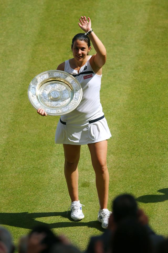 LONDON, ENGLAND - JULY 06: Marion Bartoli of France poses with the Venus Rosewater Dish trophy after her victory in the Ladies' Singles final match against Sabine Lisicki of Germany on day twelve of the Wimbledon Lawn Tennis Championships at the All England Lawn Tennis and Croquet Club on July 6, 2013 in London, England. (Photo by Julian Finney/Getty Images)