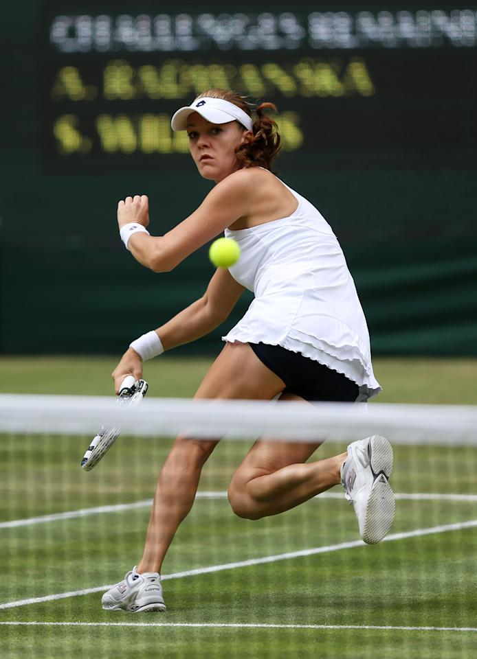 LONDON, ENGLAND - JULY 07:  Agnieszka Radwanska of Poland hits a forehand return during her Ladies' Singles final match against Serena Williams of the USA on day twelve of the Wimbledon Lawn Tennis Championships at the All England Lawn Tennis and Croquet Club on July 7, 2012 in London, England.  (Photo by Clive Rose/Getty Images)