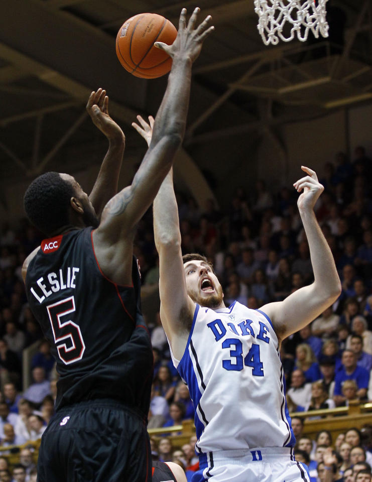 Duke's Ryan Kelly (34) shoots as North Carolina State's C.J. Leslie (5) defends during the first half of an NCAA college basketball game in Durham, N.C., Thursday, Feb. 16, 2012. (AP Photo/Gerry Broome)