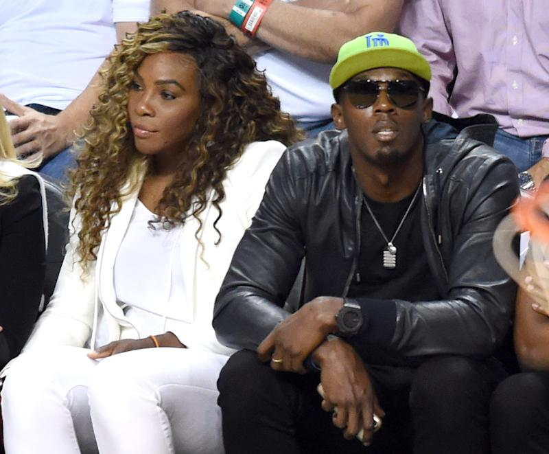 Serena Williams and Usain Bolt watch the Miami Heat and San Antonio Spurs during Game 4 of the 2014 NBA Finals on June 12, 2014 at the American Airlines Arena in Miami, Florida