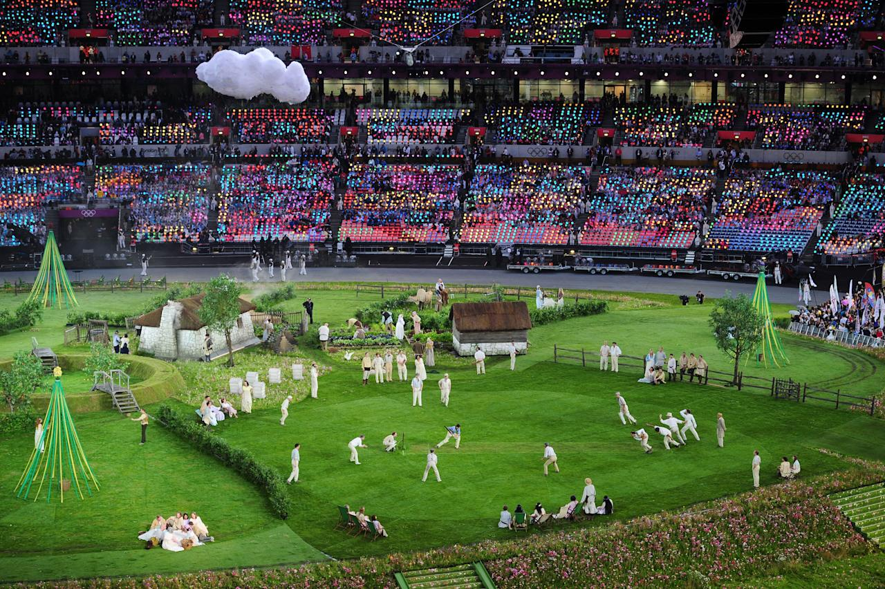 LONDON, ENGLAND - JULY 27:  Cricketers play cricket on the pitch during the preshow prior to the Opening Ceremony of the London 2012 Olympic Games at the Olympic Stadium on July 27, 2012 in London, England.  (Photo by Stu Forster/Getty Images)