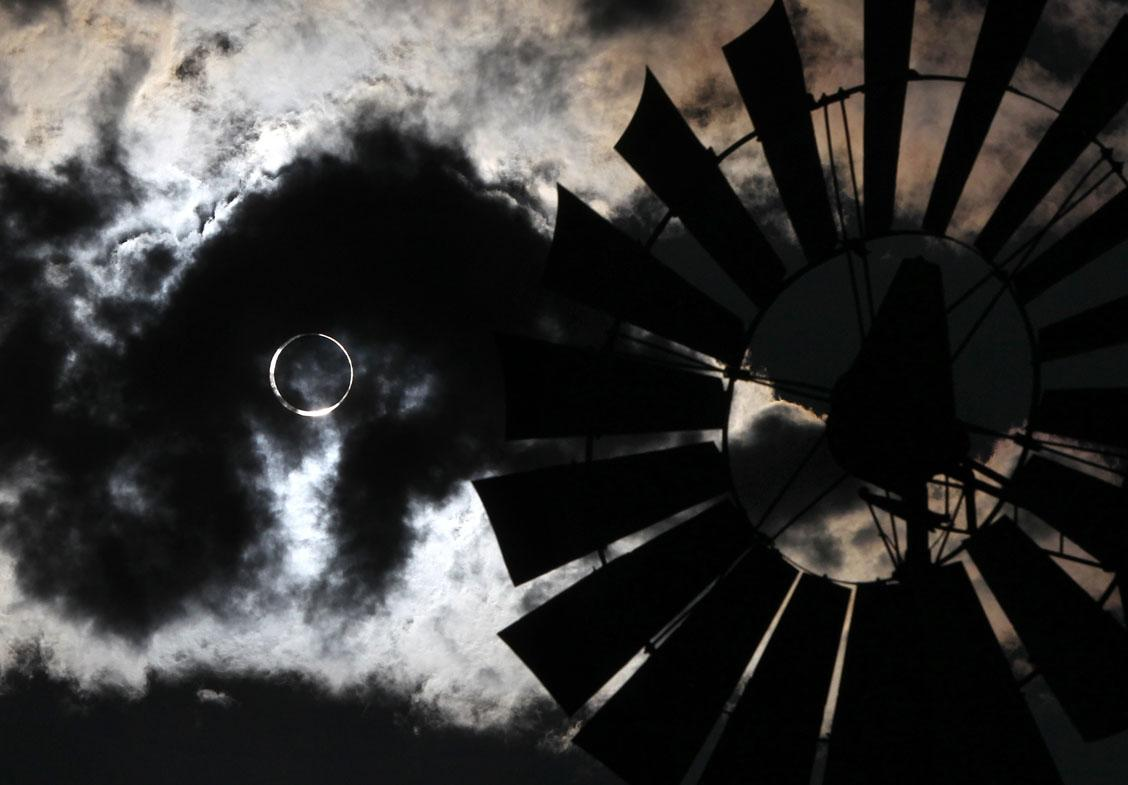 A thundershower rolls through as an annular solar eclipse appears in Gardnerville, Nev., on Sunday, May 20, 2012. (AP Photo/Cathleen Allison)