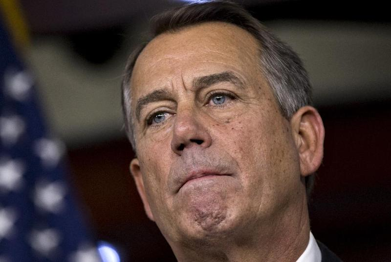 """Speaker of the House John Boehner, R-Ohio, speaks to reporters about the fiscal cliff negotiations at the Capitol in Washington, Friday, Dec. 21, 2012. Hopes for avoiding the """"fiscal cliff"""" that threatens the U.S. economy fell Friday after fighting among congressional Republicans cast doubt on whether any deal reached with President Barack Obama could win approval ahead of automatic tax increases and deep spending cuts kick in Jan. 1.  (AP Photo/J. Scott Applewhite)"""