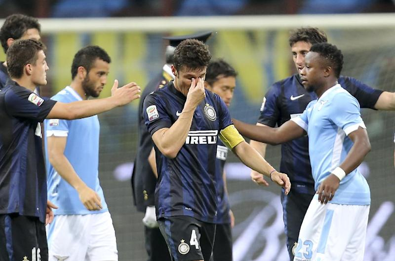 Inter Milan's Javier Zanetti,of Argentina, center, wipes his eyes at the end of the Serie A soccer match between Inter Milan and Lazio at the San Siro stadium in Milan, Italy, Saturday, May 10, 2014. Zanetti will retire after 19 seasons at Inter, and the stadium was sold out as fans packed in to bid farewell to their 40-year-old captain