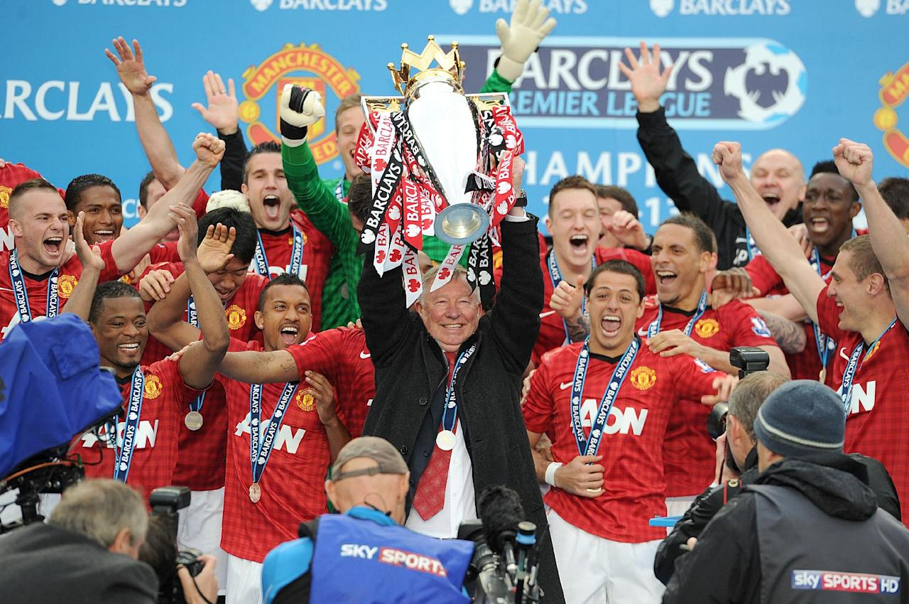 Manchester United manager Sir Alex Ferguson lifts the Barclays Premier League trophy